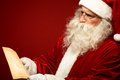 Reading letter portrait of santa claus looking at christmas in his hands Royalty Free Stock Images