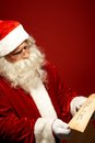 Reading letter portrait of santa claus looking at christmas in his hands Stock Photos