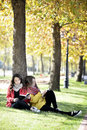 Reading in nature is my hobby girls a book a park relax the middle of autumn leisure concept Royalty Free Stock Photos