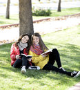 Reading in nature is my hobby girls a book a park relax the middle of autumn leisure concept Stock Photo