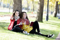 Reading in nature is my hobby girls a book a park relax the middle of autumn leisure concept Royalty Free Stock Photography