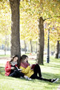 Reading in nature is my hobby girls a book a park relax the middle of autumn leisure concept Royalty Free Stock Image