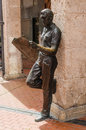 Reading newspaper sculpture of a man leaning against a column and a burgos castile and leon spain Royalty Free Stock Photos