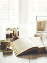 Reading opened cookbook with cookie cutters and kitchen storage bottles on background selective focus text in a book is not Royalty Free Stock Photos
