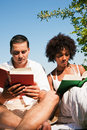 Reading outdoors Royalty Free Stock Photo