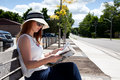 Reading outdoors elegant woman a newspaper outside Stock Images