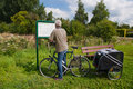 Reading the route map by biker Royalty Free Stock Photography