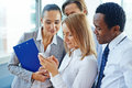 Reading sms businesswoman with cellphone and her colleagues Royalty Free Stock Images