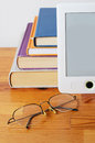 Reading stack of books e reader and glasses Stock Photography