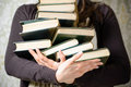 Reading student college concept woman holding pile old books studying female librarian hands copy space Stock Photography