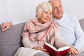 Reading together in evening at home Royalty Free Stock Photo