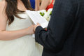 Reading wedding vow groom at ceremony Stock Image