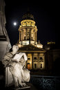 Reading woman sculpture in front of french cathedral, gendarmenmarkt, berlin at night
