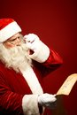 Reading xmas wish portrait of santa claus christmas letter in his hands Stock Photography