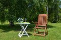 Ready for coffee paus made table with a swedish flag and a chair in garden at summertime Stock Photos