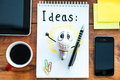 Ready for great ideas top view of note pad with coffee cup laying on the wooden desk with different business stuff around it Stock Photos