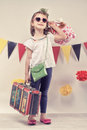 Ready for holidays pretty child with the suitcase and heart shaped glasess looking the vacation Stock Images