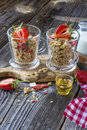 Ready-made granola with dried strawberries and almonds. Healthy breakfast  cereal muesli,   fresh Royalty Free Stock Photo