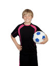 Ready for playing soccer preteen with a uniform play holding a ball isolated on white background Stock Photo