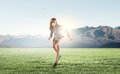 Ready steady go young businesswoman in start position to run Stock Photo
