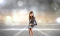 Ready steady go young businesswoman in start position to run Royalty Free Stock Photography