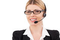 Always ready to help you confident mature customer service representative in headset looking at camera and smiling while standing Royalty Free Stock Photos