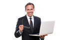 Always ready to help you confident mature man in formalwear holding laptop and smiling while standing isolated on white background Royalty Free Stock Image