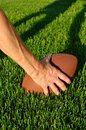 Ready to Hike Football on a grass playing field Royalty Free Stock Photo