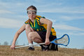 Ready to rock sporty girl poised and for lacrosse Stock Image