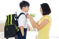 Ready to school asian mother get her son Royalty Free Stock Images