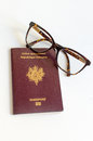 Ready to travel european passport with a pair of glasses Royalty Free Stock Images