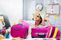 Ready for vacations smiling female office worker to leave with pink luggage Stock Photos