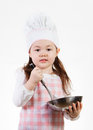 Almost ready a young girl enjoys cooking up something good to eat Stock Photos
