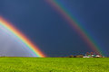 Real double rainbow beautiful and green field Stock Photo
