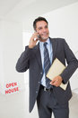 Real estate agent with documents using mobile phone Royalty Free Stock Photo