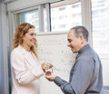 Real estate agent giving keys to client female new home buyer Stock Photo