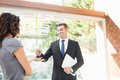 Real-estate agent giving keys Royalty Free Stock Photo
