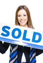 Real Estate Agent Holding Sold Sign Royalty Free Stock Image