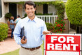 Real estate agent at work outside a property Royalty Free Stock Photo