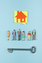 Real Estate concept. Construction building. Blank speech bubbles, people toy figures, paper model house, blueprints with