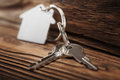 Real estate concept, Key ring and keys on wooden background Royalty Free Stock Photo