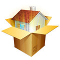 Real estate concept little house inside cardboard shipping box Royalty Free Stock Images