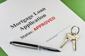 Real estate mortgage approved loan document with pen and house keys Stock Photo
