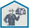 Real estate salesman sell house retro illustration of sales agent wearing hat holding a on his hand set inside shiled on Royalty Free Stock Images