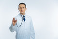 Real medical professional with stethoscope listening to patient heart Royalty Free Stock Photo