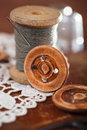 Real old reels spoons treads with needle and thimble on old wood wooden table Stock Photo