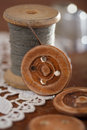 Real old reels spoons treads with needle and thimble on old wood wooden table Royalty Free Stock Photo