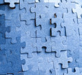 Real photograph of the backside of blue puzzle jigsaw in available light Royalty Free Stock Photo