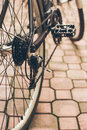 Real repair of bicycle in the court pavement reparing low perspective retro colors vintage look Stock Photos
