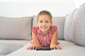 Real toddler girl working homework with tablet device Royalty Free Stock Photo